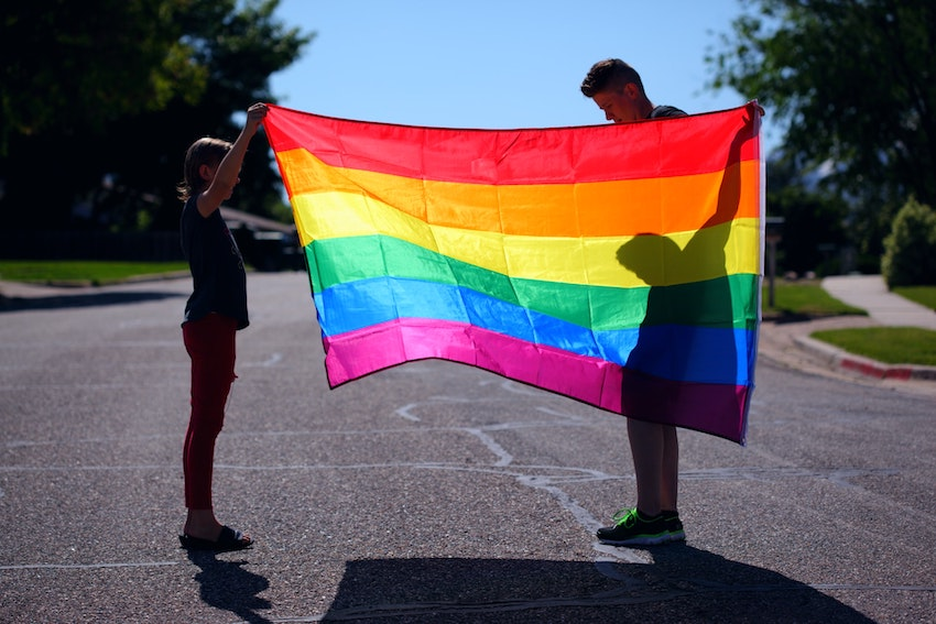 holding a flag for pride month