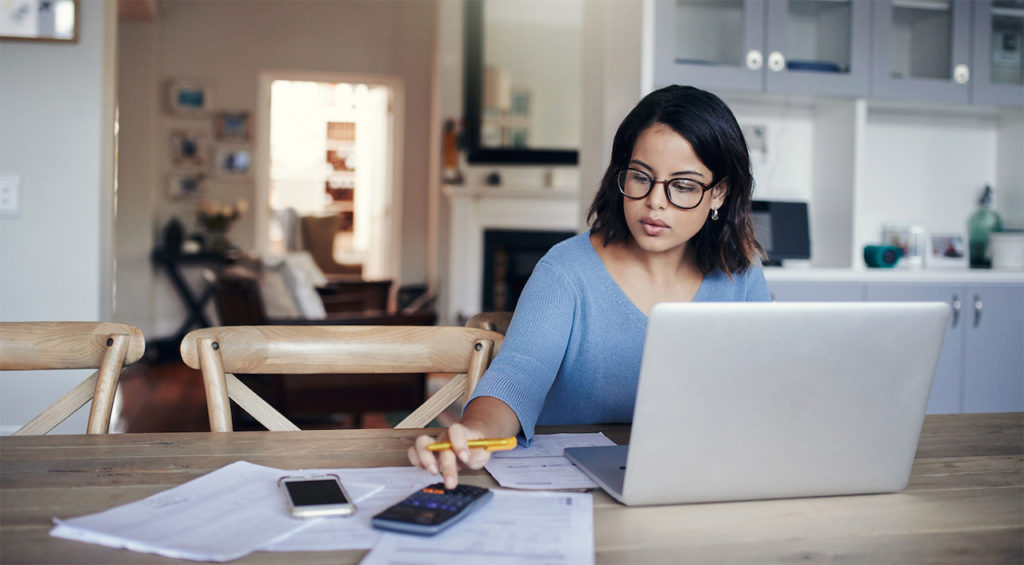 a woman calculating her mortgage interest rates